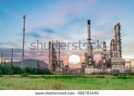 Oil refinery at twilight, Petrochemical plant, factory Oil refinery at twilight, oil refinery sunset. - stock photo
