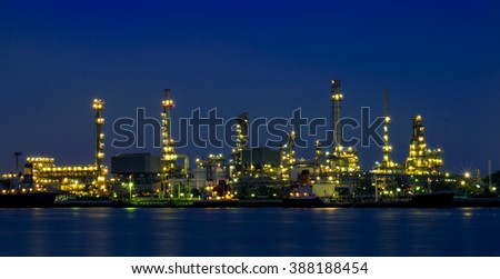 Oil refinery at twilight, river side thailand