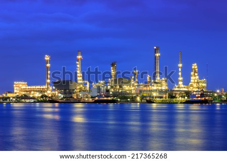 Oil refinery at twilight with reflection