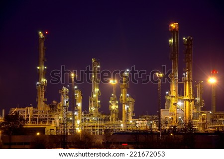 Oil refinery buildings at night