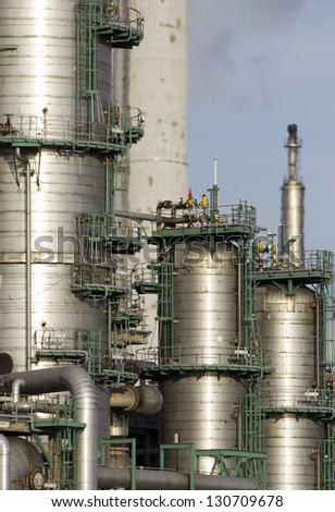 Oil-refinery distillation tanks - stock photo