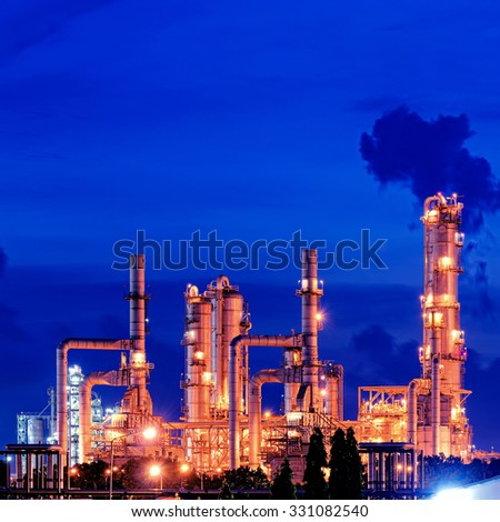 oil refinery distillation tower - stock photo