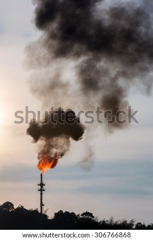 oil refinery Distillation tower with smoke stack pollution - stock photo