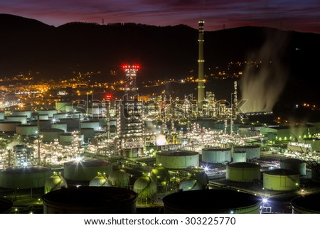 oil refinery during sunset time - stock photo
