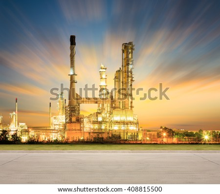 Oil refinery factory and concrete pavement at twilight with sky background. - stock photo