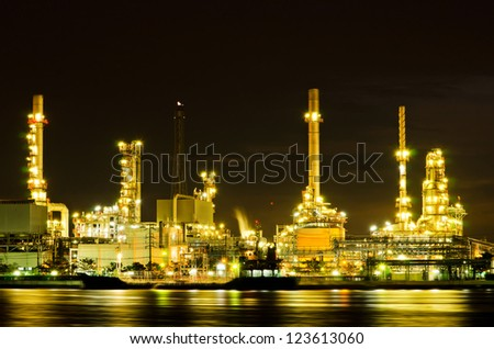 Oil refinery factory at night in Bangkok, Thailand - stock photo