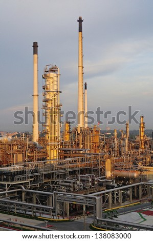 Oil Refinery factory at sunset - stock photo