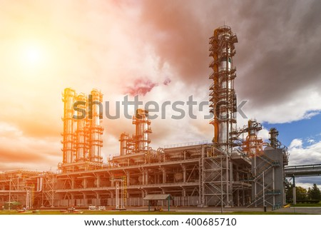 Oil Refinery factory at the cloudy sky, petrochemical plant, Petroleum - stock photo