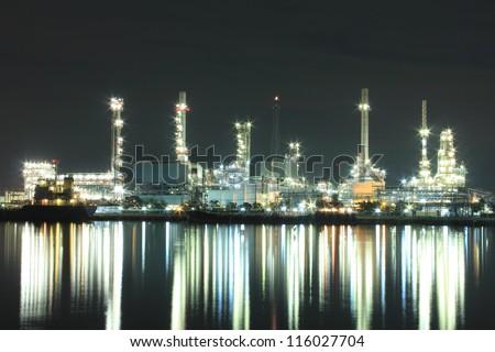 Oil refinery factory at twilight, Chao Phraya river, Thailand - stock photo