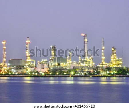 Oil Refinery factory during twilight. - stock photo