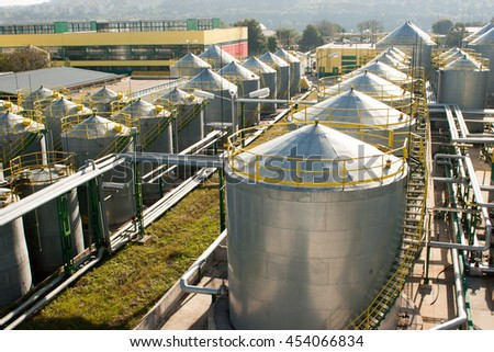 Oil refinery factory, industrial petrol tanks