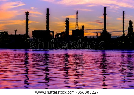 Oil refinery factory over sunrise Bangkok Thailand,Oil refinery with silhouette