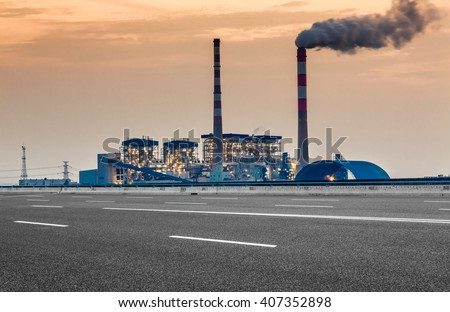 oil refinery factory under the cloudy sky - stock photo