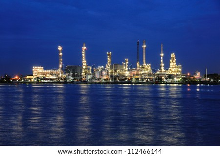 Oil refinery factory with reflection in Bangkok, Thailand.
