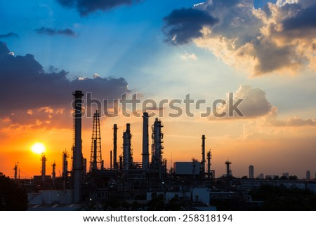 Oil Refinery in Sunset - stock photo