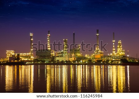 Oil refinery industrial plant at night - stock photo