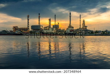 oil refinery industry plant at sunrise morning - stock photo