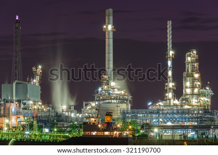 Oil Refinery industry plant with the boat parking near riverside in Bangkok, Thailand. - stock photo