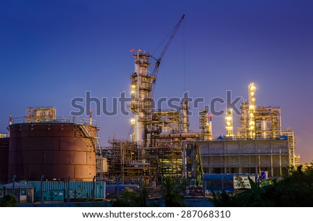 Oil refinery is running at night - stock photo