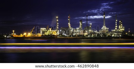 Oil refinery or petrochemical industry with ship and speed light at night in thailand.