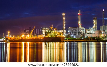 Oil refinery or petrochemical industry with ship at night in thailand. for Logistic Import Export background
