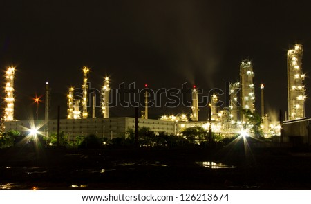 Oil refinery petrochemical industry at night scene