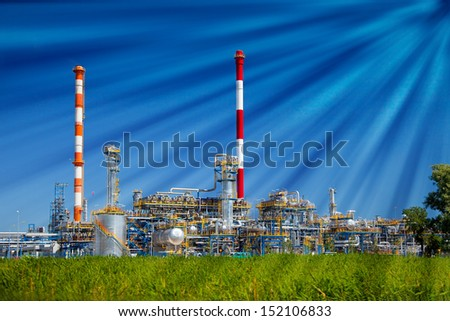 Oil refinery petrochemical industry plant on blue sky background.