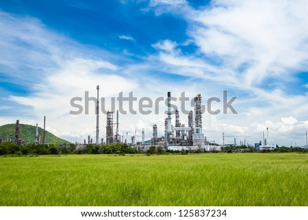 oil refinery plant against blue sky - stock photo