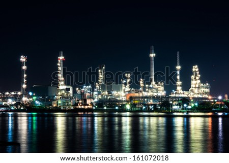 Oil refinery plant at night time  - stock photo