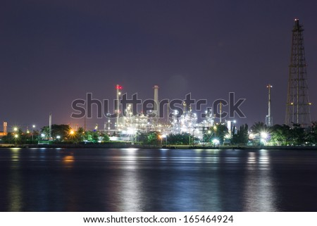 Oil refinery plant at twilight - stock photo