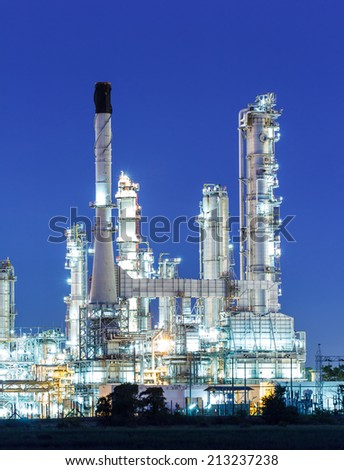 Oil refinery plant at twilight dark blue sk - stock photo