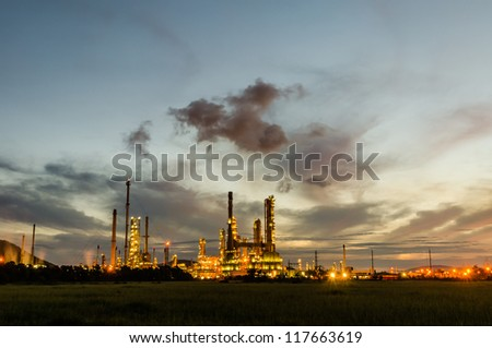 Oil refinery plant at twilight dark blue sky.