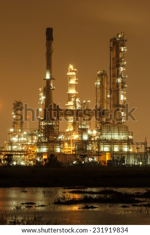 Oil refinery plant at twilight dark blue sky