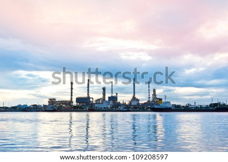 Oil refinery plant at twilight morning along river in Bangkok