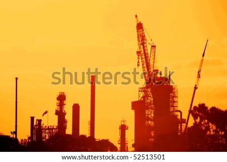 oil refinery power mill against orange sunset - stock photo