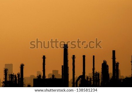 Oil refinery silhouette with space for text