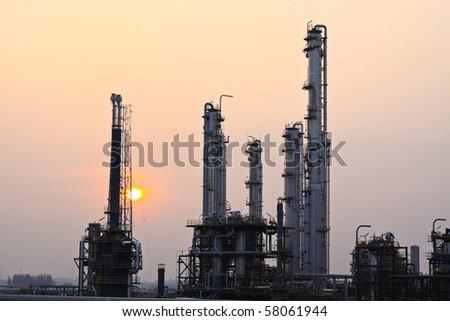 Oil refinery sunset - stock photo
