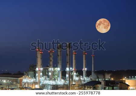Oil Refinery twilight with moon in thailand. - stock photo