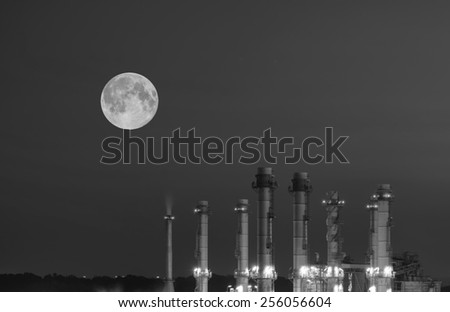 Oil Refinery twilight with moon industrial black and white tone. - stock photo
