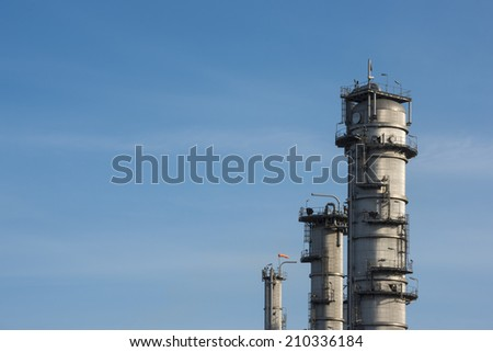 Oil refinery with blue sky - stock photo