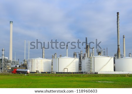 oil refinery with fuel tanker passing by