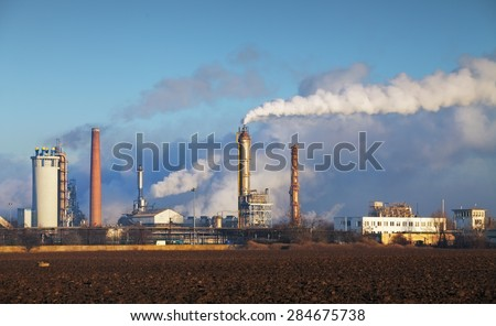 Oil refinery with vapor - petrochemical industry. - stock photo