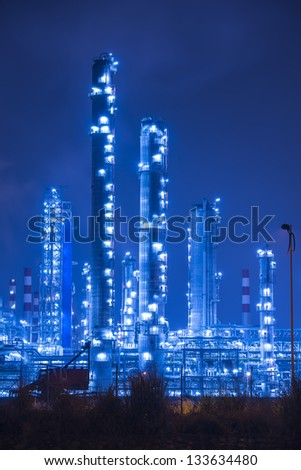 Oil refinery working at night - stock photo