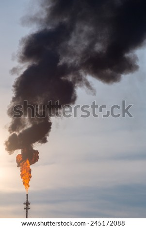 oil reinery Distillation tower with smoke stack pollution - stock photo