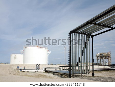 Oil reservoir. Oil and gas refinery plant. Industrial scene refinery plant. Gas station - stock photo