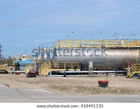 Oil reservoir on a background of blue sky
