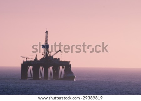 oil rig and offshore vessel at the sunset