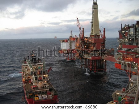 Oil rig being supplied. - stock photo