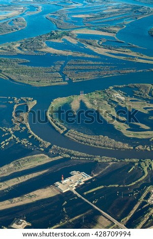 Oil rig in flooded area near great river, top view - stock photo