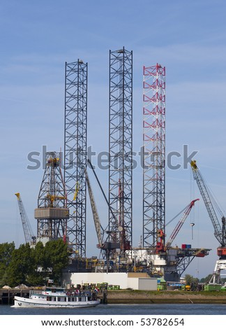 oil rig in the harbour od rotterdam - stock photo